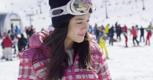 Pretty woman at ski resort stock footage