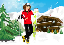Pretty woman skier in mountain resort. Pretty woman skier enjoy her winter vacation in mountain resort  wearing ski suit, standing with mountain skis against Stock Images