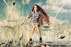 Pretty woman on a sky Royalty Free Stock Image