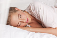 Pretty woman sleeping in the bed Royalty Free Stock Photo