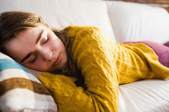 Pretty woman sleeping on the couch Stock Photos