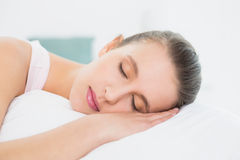 Pretty woman sleeping with eyes closed in bed Royalty Free Stock Photo