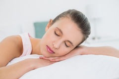 Pretty woman sleeping with eyes closed in bed Stock Images