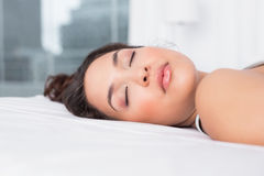 Pretty woman sleeping with eyes closed in bed Royalty Free Stock Photography
