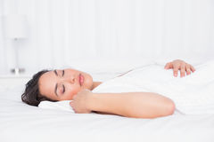 Pretty woman sleeping with eyes closed in bedroom Stock Photo