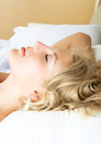 Pretty woman sleeping in her bed at home Stock Image