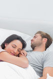 Pretty woman sleeping on her husbands chest Stock Photography