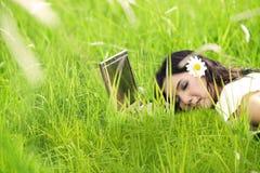 Pretty woman sleeping on laptop Stock Photo