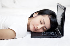Pretty woman sleeping with laptop Royalty Free Stock Images
