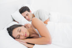 Pretty woman sleeping next to her partner Royalty Free Stock Photo