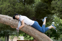 Pretty woman sleeping in a tree after being over worked and having trouble sleeping Royalty Free Stock Photos