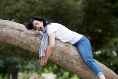Pretty woman sleeping in a tree after being over worked and having trouble sleeping Stock Photography