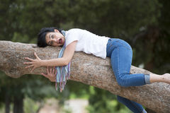 Pretty woman sleeping in a tree after being over worked and having trouble sleeping Royalty Free Stock Image