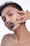 Pretty woman smear out black color lips. Pretty woman smear out black color lips Stock Photo