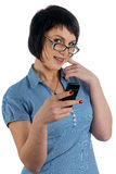 Pretty woman smiles with phone in hand Stock Image