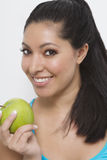 Pretty woman smiling with apple Stock Photo