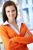 Pretty woman smiling arms crossed Stock Image