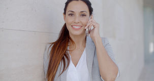 Pretty woman smiling as she chats on a mobile Royalty Free Stock Photos