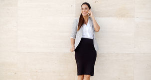 Pretty woman smiling as she chats on a mobile Royalty Free Stock Photo