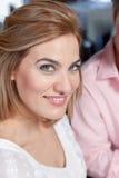 Pretty woman smiling. At camera Stock Photos