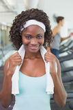 Pretty woman smiling at camera beside treadmills Stock Photo