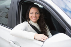 Pretty woman smiling and driving Stock Photography