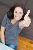 Pretty woman smiling with her thumb up Royalty Free Stock Images