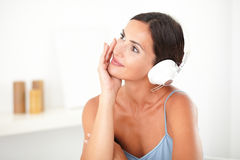 Pretty woman smiling while listening to music Royalty Free Stock Image