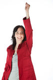 Pretty woman smiling and raising an arm Stock Photos