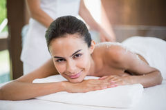Pretty woman smiling while receiving spa treatment Stock Photography