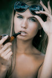 Pretty woman smoke tobacco-pipe Royalty Free Stock Images