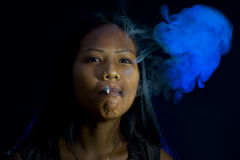 Pretty woman smoking Stock Images