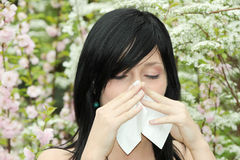 Pretty woman sneeze Stock Photos