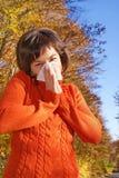 Pretty woman sneeze Stock Photos