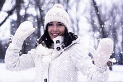 Pretty woman with snowball Royalty Free Stock Photos