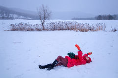 Pretty woman in snowfield Stock Images