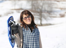 Pretty woman with snowshoes in the mountains royalty free stock images