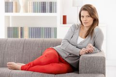 Pretty woman on sofa Stock Photo