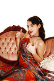 Pretty woman on sofa. Royalty Free Stock Photos
