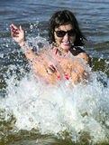 Pretty woman in the sparks of water Stock Images