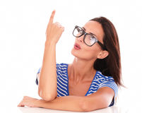 Pretty woman with spectacles pointing up Royalty Free Stock Photo