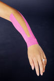 Pretty woman with sports taping on the body Stock Images