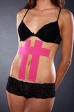 Pretty woman with sports taping on the body Royalty Free Stock Image