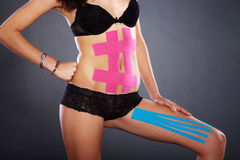 Pretty woman with sports taping on the body Royalty Free Stock Photography