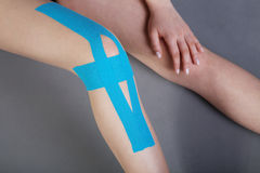 Pretty woman with sports taping on the body Stock Photography