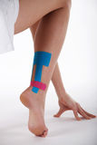 Pretty woman with sports taping on the body Stock Photos
