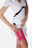 Pretty woman with sports taping on the body Royalty Free Stock Photo