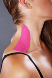 Pretty woman with sports taping on the body Stock Image