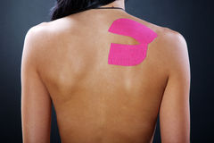 Pretty woman with sports taping on the body Stock Photo