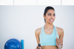 Pretty woman in sportswear holding a rope Stock Photo